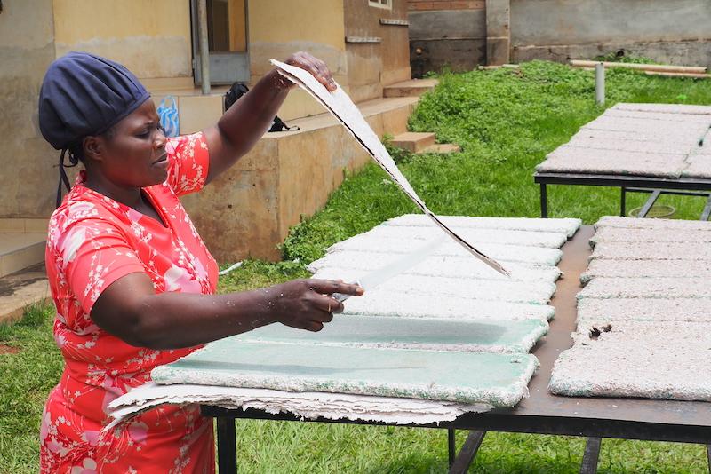 MakaPads employee cutting dried sheets